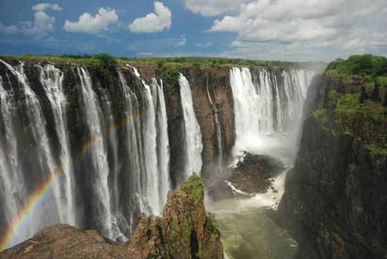 """As the Zambezi River crosses the border of Zambia and Zimbabwe, it plunges 108 metres down in a stunning waterfall that is 1.7km wide. The falls are also called Mosi-oa-Tunya, meaning """"Smoke that Thunders"""" in the Kalolo-Lozi tribe's dialect."""