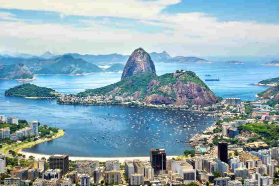 Located in Brazil, the Harbour of Rio de Janeiro is surrounded by unique granite mountains that were formed by erosion from the Atlantic Ocean. It is also known as Guanabara Bay, and is the source of the famous image of the white stone statue of Christ the Redeemer atop Corcovado Mountain, facing the sea with his arms outstretched.