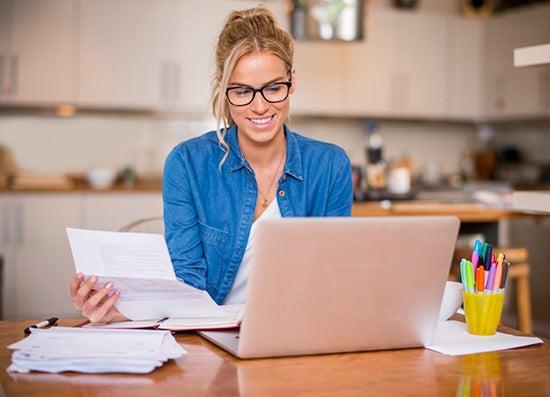 Woman budgeting on computer