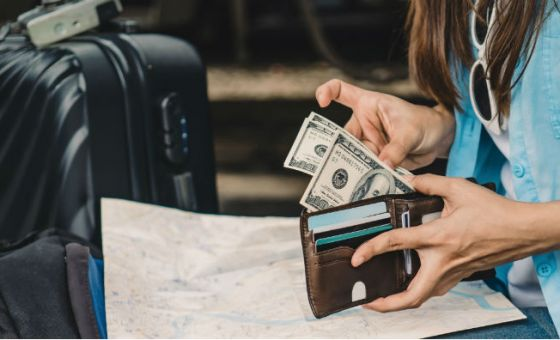 be careful if you're using cash while travelling