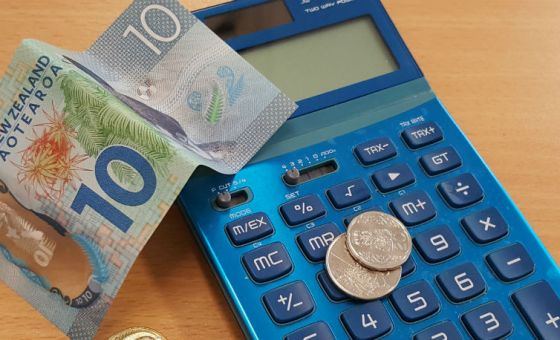 calculator and New Zealand money