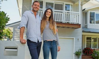 young couple outside new house