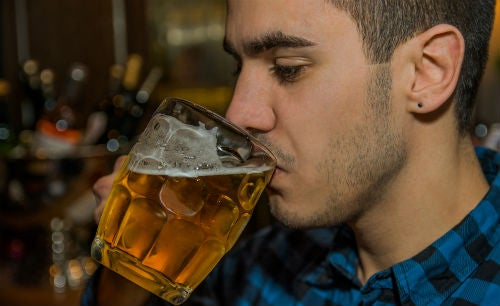 Student drinks a jug of beer at the bar