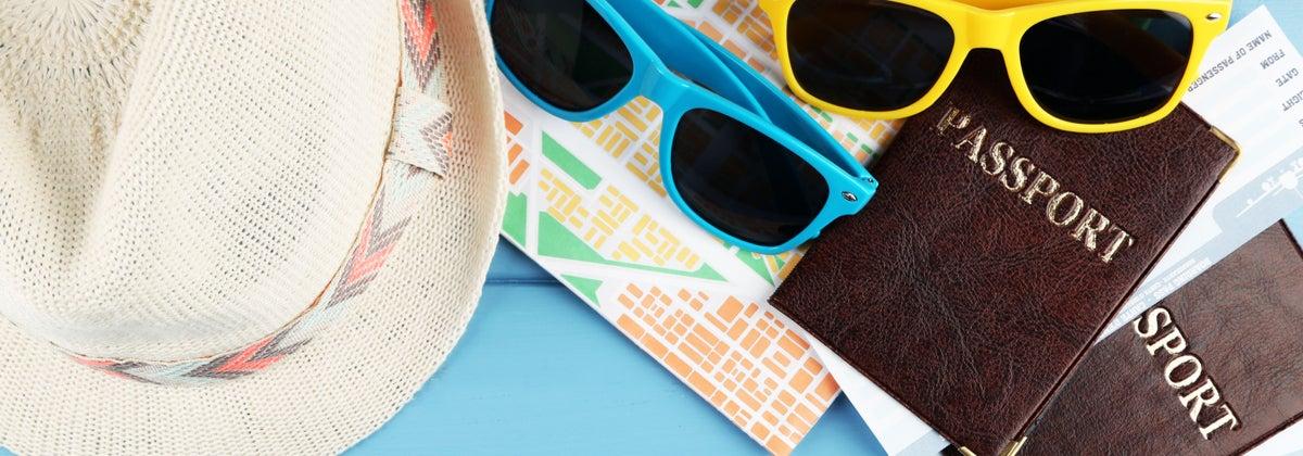 Sunglasses, hats and passports - holiday essentials