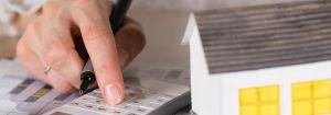woman calculating capital gains tax